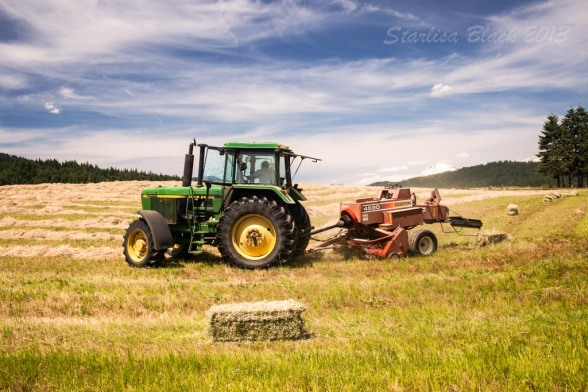 tractor in the hay field hard at work near Husum, WA