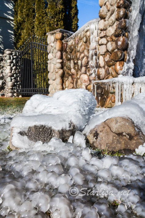 Ice from the Weeping wall at Bonneville Hotsprings resort covers every nearby surface with rounded shimmery borbules of ice on February 5, 2014