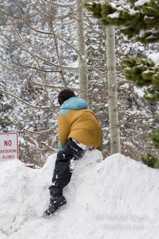king dethroned.. one slip of the foot and down goes the boy on the snow.