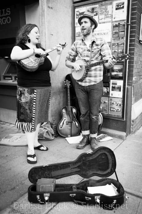 """The Quiet American"" - a musician busking on the street of Hood River, Oregon, during a First Friday gallery walk event"