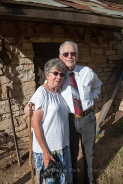 my brother Dennis Black and wife Donetta in front of the old Milk house built by Grandpa Stevens