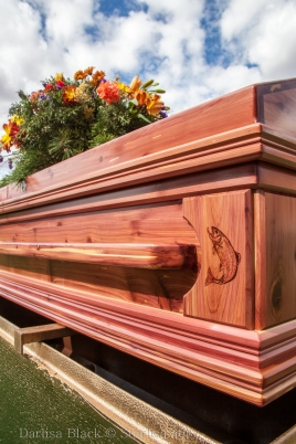 notice the fish burned into the corner of this lovely red cedar casket.